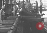 Image of Filipino men working under Japanese occupation Manila Philippines, 1942, second 19 stock footage video 65675050780