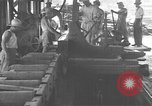 Image of Filipino men working under Japanese occupation Manila Philippines, 1942, second 21 stock footage video 65675050780