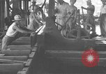 Image of Filipino men working under Japanese occupation Manila Philippines, 1942, second 25 stock footage video 65675050780