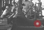 Image of Filipino men working under Japanese occupation Manila Philippines, 1942, second 28 stock footage video 65675050780