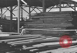 Image of Filipino men working under Japanese occupation Manila Philippines, 1942, second 36 stock footage video 65675050780