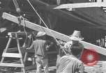 Image of Filipino men working under Japanese occupation Manila Philippines, 1942, second 43 stock footage video 65675050780