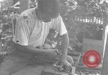 Image of Filipino men working under Japanese occupation Manila Philippines, 1942, second 49 stock footage video 65675050780