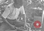 Image of Filipino men working under Japanese occupation Manila Philippines, 1942, second 50 stock footage video 65675050780