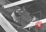 Image of Filipino men working under Japanese occupation Manila Philippines, 1942, second 62 stock footage video 65675050780