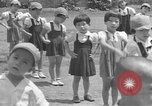 Image of Filipino people during Japanese occupation Manila Philippines, 1942, second 20 stock footage video 65675050781