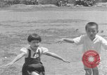 Image of Filipino people during Japanese occupation Manila Philippines, 1942, second 27 stock footage video 65675050781