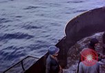 Image of CV-6 USS Enterprise aftermath of kamikaze attack Pacific Ocean, 1945, second 14 stock footage video 65675050833