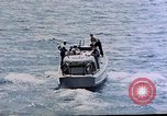 Image of motor launch Pacific Ocean, 1945, second 15 stock footage video 65675050839