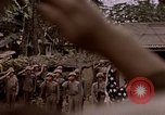 Image of American flag raising ceremony Saipan Northern Mariana Islands, 1944, second 3 stock footage video 65675050871