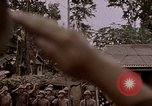 Image of American flag raising ceremony Saipan Northern Mariana Islands, 1944, second 4 stock footage video 65675050871