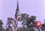 Image of American flag raising ceremony Saipan Northern Mariana Islands, 1944, second 40 stock footage video 65675050871
