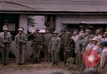Image of American flag raising ceremony Saipan Northern Mariana Islands, 1944, second 57 stock footage video 65675050871