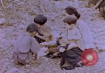 Image of American infantry searching hideouts on Saipan for Japanese soldiers Saipan Northern Mariana Islands, 1944, second 18 stock footage video 65675050872