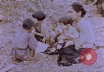 Image of American infantry searching hideouts on Saipan for Japanese soldiers Saipan Northern Mariana Islands, 1944, second 20 stock footage video 65675050872
