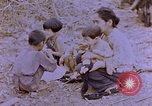 Image of American infantry searching hideouts on Saipan for Japanese soldiers Saipan Northern Mariana Islands, 1944, second 21 stock footage video 65675050872