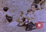 Image of American infantry searching hideouts on Saipan for Japanese soldiers Saipan Northern Mariana Islands, 1944, second 22 stock footage video 65675050872