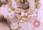 Image of American infantry searching hideouts on Saipan for Japanese soldiers Saipan Northern Mariana Islands, 1944, second 32 stock footage video 65675050872