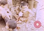 Image of American infantry searching hideouts on Saipan for Japanese soldiers Saipan Northern Mariana Islands, 1944, second 34 stock footage video 65675050872
