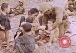 Image of American infantry searching hideouts on Saipan for Japanese soldiers Saipan Northern Mariana Islands, 1944, second 36 stock footage video 65675050872