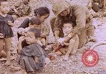 Image of American infantry searching hideouts on Saipan for Japanese soldiers Saipan Northern Mariana Islands, 1944, second 38 stock footage video 65675050872