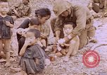 Image of American infantry searching hideouts on Saipan for Japanese soldiers Saipan Northern Mariana Islands, 1944, second 39 stock footage video 65675050872