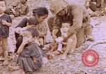 Image of American infantry searching hideouts on Saipan for Japanese soldiers Saipan Northern Mariana Islands, 1944, second 40 stock footage video 65675050872