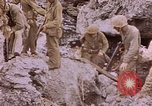 Image of American infantry searching hideouts on Saipan for Japanese soldiers Saipan Northern Mariana Islands, 1944, second 43 stock footage video 65675050872