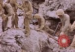 Image of American infantry searching hideouts on Saipan for Japanese soldiers Saipan Northern Mariana Islands, 1944, second 44 stock footage video 65675050872
