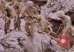 Image of American infantry searching hideouts on Saipan for Japanese soldiers Saipan Northern Mariana Islands, 1944, second 45 stock footage video 65675050872