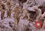 Image of American infantry searching hideouts on Saipan for Japanese soldiers Saipan Northern Mariana Islands, 1944, second 46 stock footage video 65675050872