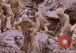 Image of American infantry searching hideouts on Saipan for Japanese soldiers Saipan Northern Mariana Islands, 1944, second 47 stock footage video 65675050872