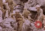 Image of American infantry searching hideouts on Saipan for Japanese soldiers Saipan Northern Mariana Islands, 1944, second 48 stock footage video 65675050872