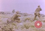 Image of American infantry searching hideouts on Saipan for Japanese soldiers Saipan Northern Mariana Islands, 1944, second 49 stock footage video 65675050872
