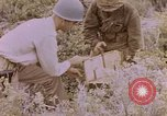 Image of American infantry searching hideouts on Saipan for Japanese soldiers Saipan Northern Mariana Islands, 1944, second 57 stock footage video 65675050872