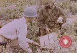 Image of American infantry searching hideouts on Saipan for Japanese soldiers Saipan Northern Mariana Islands, 1944, second 58 stock footage video 65675050872