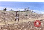 Image of American soldiers search a Japanese youth in uniform Saipan Northern Mariana Islands, 1944, second 3 stock footage video 65675050873