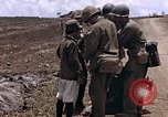 Image of American soldiers search a Japanese youth in uniform Saipan Northern Mariana Islands, 1944, second 11 stock footage video 65675050873