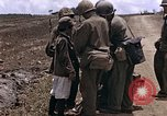 Image of American soldiers search a Japanese youth in uniform Saipan Northern Mariana Islands, 1944, second 12 stock footage video 65675050873