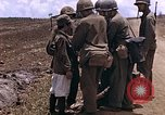 Image of American soldiers search a Japanese youth in uniform Saipan Northern Mariana Islands, 1944, second 14 stock footage video 65675050873