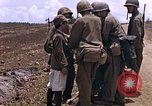 Image of American soldiers search a Japanese youth in uniform Saipan Northern Mariana Islands, 1944, second 15 stock footage video 65675050873
