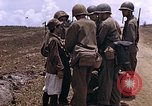 Image of American soldiers search a Japanese youth in uniform Saipan Northern Mariana Islands, 1944, second 16 stock footage video 65675050873