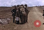 Image of American soldiers search a Japanese youth in uniform Saipan Northern Mariana Islands, 1944, second 19 stock footage video 65675050873