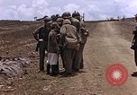 Image of American soldiers search a Japanese youth in uniform Saipan Northern Mariana Islands, 1944, second 20 stock footage video 65675050873