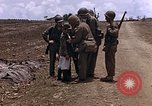 Image of American soldiers search a Japanese youth in uniform Saipan Northern Mariana Islands, 1944, second 21 stock footage video 65675050873