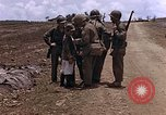 Image of American soldiers search a Japanese youth in uniform Saipan Northern Mariana Islands, 1944, second 22 stock footage video 65675050873