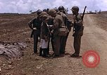 Image of American soldiers search a Japanese youth in uniform Saipan Northern Mariana Islands, 1944, second 23 stock footage video 65675050873