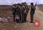 Image of American soldiers search a Japanese youth in uniform Saipan Northern Mariana Islands, 1944, second 24 stock footage video 65675050873