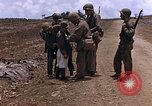 Image of American soldiers search a Japanese youth in uniform Saipan Northern Mariana Islands, 1944, second 25 stock footage video 65675050873