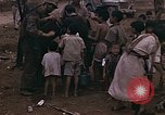 Image of American soldiers search a Japanese youth in uniform Saipan Northern Mariana Islands, 1944, second 29 stock footage video 65675050873